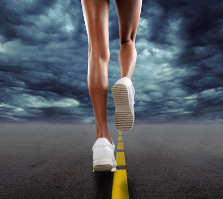 Woman jogging on a stormy day