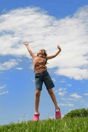 Young girl jumping outdoors photo
