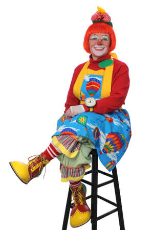 CLown sitting and smiling isolated over a white background photo