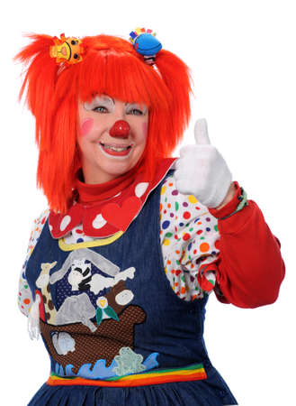 Smiling clown with orange hair showing approval photo