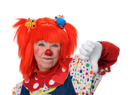 Clown in orange hair showing disapproval photo