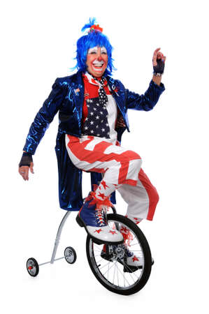 training wheels: Clown riding a unicycle with training wheels