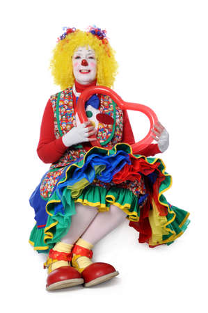 Clown sitting and holding a balloon heart photo
