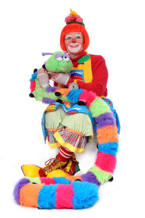 Colorful clown sitting with pet worm photo