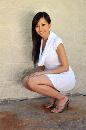Young Asian woman posing in white dress Stock Photo - 7803686