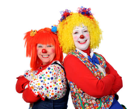clowns: Two clown smiling isolated over a white background