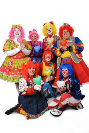 fair hair: Group of clowns holding hearts isolated over a white background