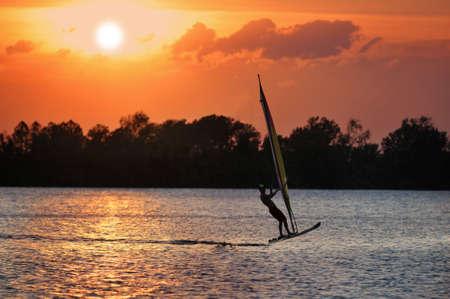 Windsurfer during a sunset Stock Photo - 7795105