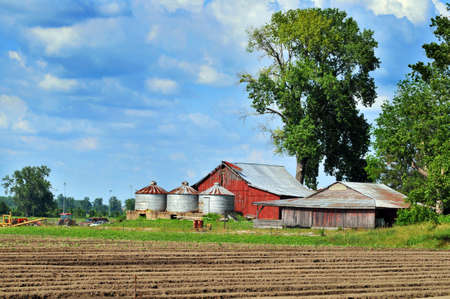 Country barn with silos during a sunny day photo
