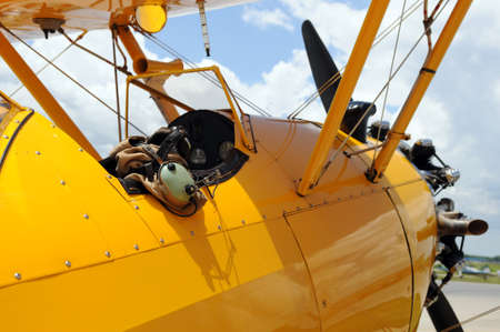 Vintage airplane detail showing cockpit and pilot gear photo