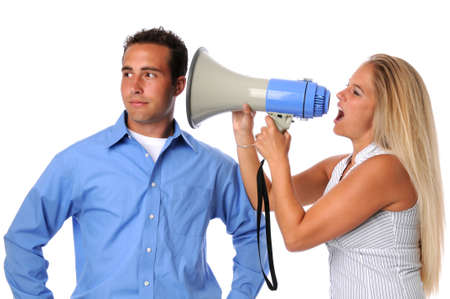 uninterested: Young woman using megaphone to communicate to uninterested man