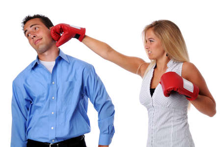 Young woman hitting man with boxing gloves