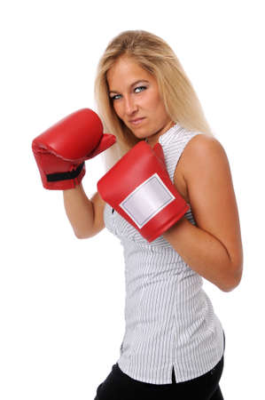 Young Businesswoman with boxing training gloves photo