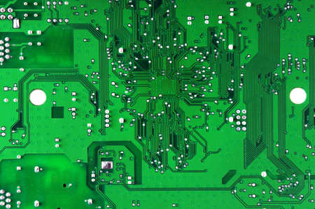 fluorescence: Green computer circuit board Stock Photo