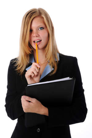Beautiful businesswoman holding a pencil and a folder photo