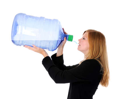 big bin: Portrait of young businesswoman drinking water from a large container Stock Photo