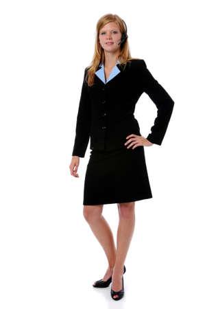 earpiece: Beautiful businesswoman with wireless earpiece standing