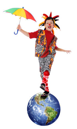 Young clown balancing on planet earth photo