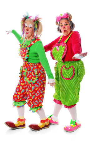 Two clowns playing isolated over a white background photo