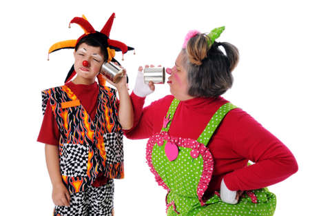 Clowns using tin can phones isolated over a white background photo