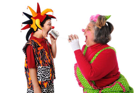 Clowns yelling at each other using thin can phones photo