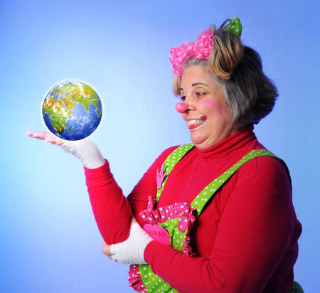 Clown holding the earth in her hand photo