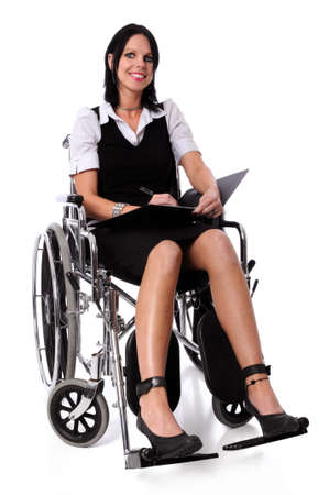 Young woman on a wheel chair with folder and pen smiling photo