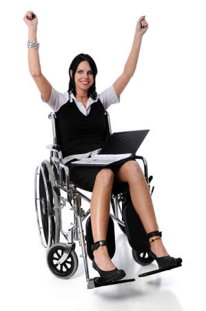 Young woman sitting on wheelchair expressing victory