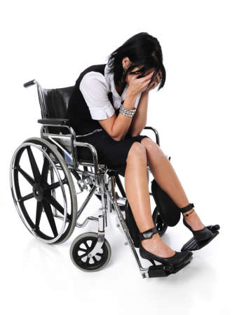 Young woman crying sitting on a wheelchair