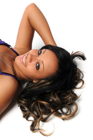Beautiful African American woman laying on the floor smiling photo