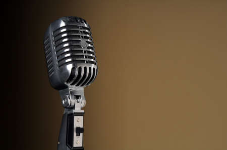 Vintage microphone over a gradient background photo