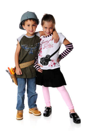 Boy dressed as construction worker and girl as a star Imagens
