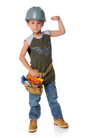 strong: Young boy dressed as construction worker isolated over a white background