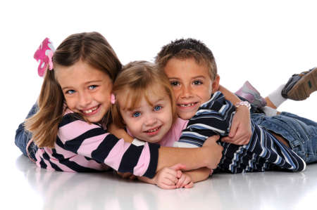 blond boy: Children embracing laying on the floor over a white background Stock Photo
