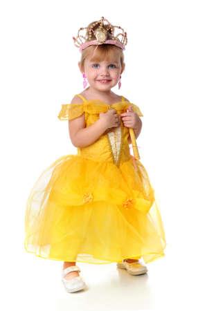 kids costume: Little Princess with yellow dress and magic wand Stock Photo