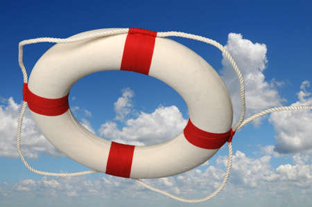 Life preserver with rope against a sky photo