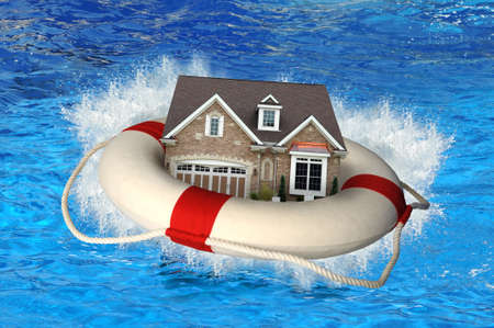 House market crisis represented by house and life preserver crashing on water Stock Photo - 7804550