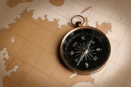 Compass on a vintage map Stock Photo - 7804486