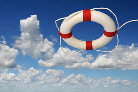 Lifepreserver over blue sky with clouds
