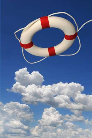 preserver: Life preserver over a blue sky with bright clouds Stock Photo