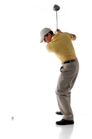 Studio shot of golfer hitting the ball isolated over a white background