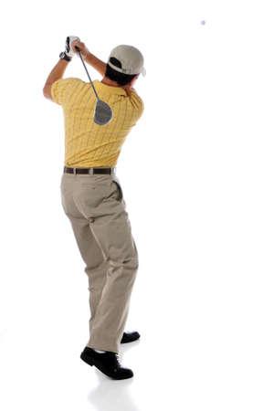 hitting: Golfer watching ball after swinging