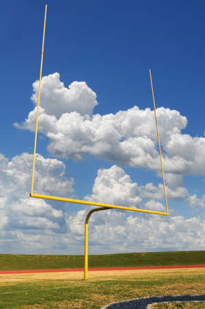 post: Football goal on a bright sunny day Stock Photo