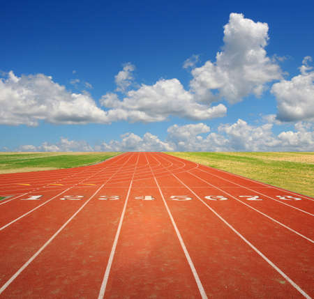 race track: Running track with eight lanes with sky and clouds Stock Photo