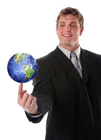 Businessman balancing earth on his finger isolated over a white background photo