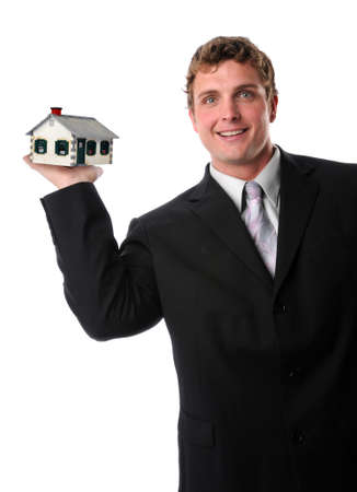 Man holding a small home in hand isolated over a white background Stock Photo - 7887395