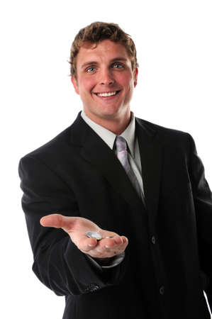 Young businessman holding coins in his hand isolated over a white background photo