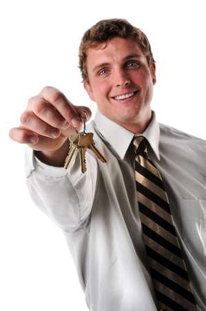 Portrait of businessman holding keys photo