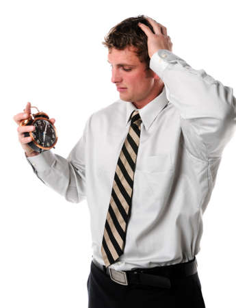 Businessman holding alarm clock and worried about time Stock Photo - 7887397