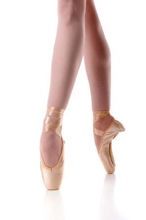 dancing shoe: Ballerinas feet in pointe over a white background